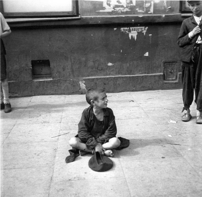 Warsaw, Poland, A boy begging on the pavement on a street in the ghetto, 19/09/1941