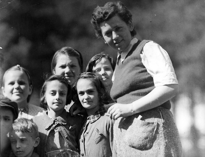 Bergen-Belsen, Germany, 1945, A woman and children after the liberation
