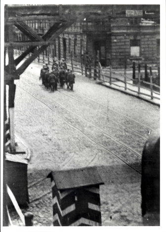 Lodz, Poland. 1943. German policemen changing guard at the entrance to the ghetto.
