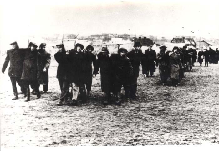 Pallbearers carrying the victims of the Kielce pogrom