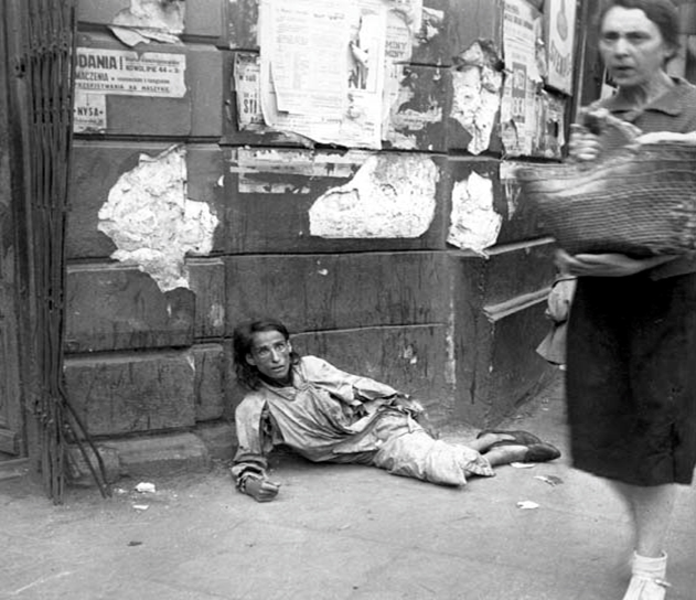A starving woman lying on a ghetto street, Warsaw, Poland, September 19, 1941