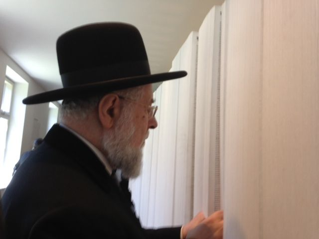 Rabbi Lau, Chairman of the Yad Vashem Council, looking at the Book of Names at the new permanent exhibition SHOAH in Block 27 at Auschwitz-Birkenau
