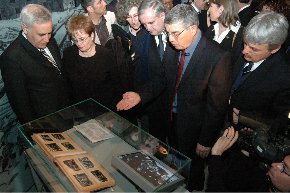 Leaders from the around the world view a gallery in the New Museum depicting the Final Solution