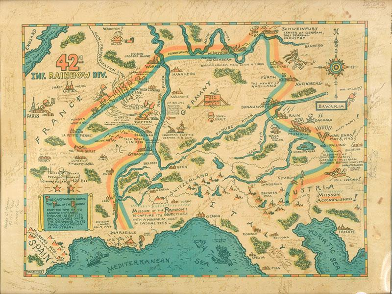 """A map showing """"The Trail of the Rainbow """" – the route taken by the 42nd Infantry Rainbow Division of the American Army through Europe. It is covered with messages from the soldiers to Marcel."""
