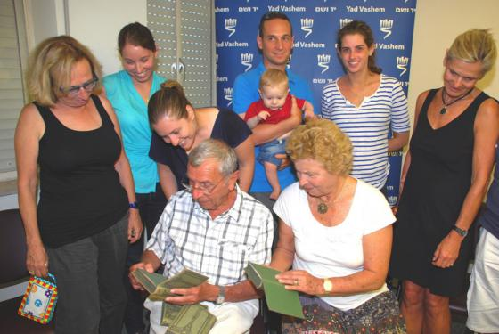 Mosher Hofstadter accompanied by his extended family receiving his father's books at Yad Vashem