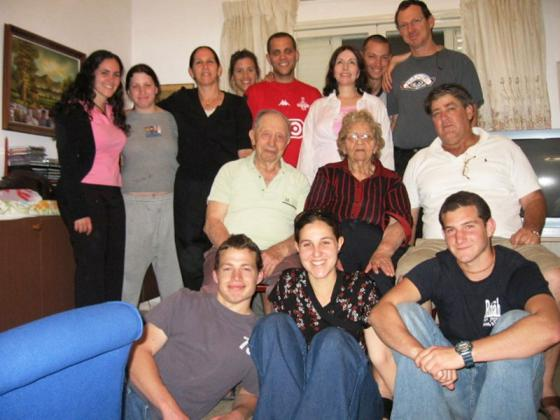 A family reunited: Center row, left to right, Paula and Moshe Eizenberg, Amir Margalit, Front row, center, Nurit Margalit. May 2006