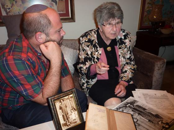 "Dr. Yishai Shachor and Esther Rosenberg pictured with the ""Machzor"" (high holiday prayer book) that originally belonged to Margitte Rosenberg (May 2012)"