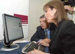 Limor Livnat, Minister of Education, Culture and Sport searches the Database with Avner Shalev, Chairman of the Yad Vashem Directorate
