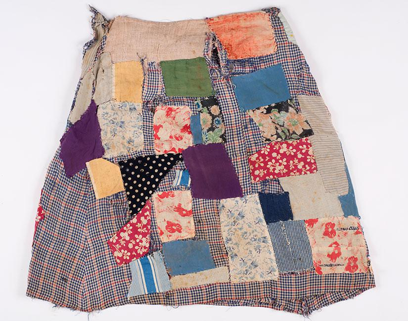 Dress in which Roza Rosenstrauss was deported from her home and later recreated as a patchwork skirt in Transnistria