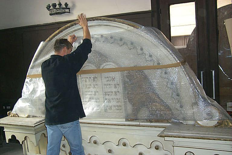 Torah Arks being packed in a building in the Bucharest cemetery, in preparation for transfer to Yad Vashem. Romania, 1999
