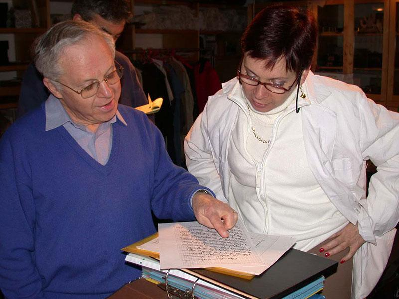 Ehud Lev presenting the book he received from the family that hid him, with Haviva Peled-Carmeli, Director of the Artifacts Department, January 2002