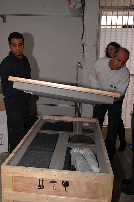 Shipping company workers packing Museum artifacts in preparation for loan to the Museum of Jewish Heritage, New York, 2007