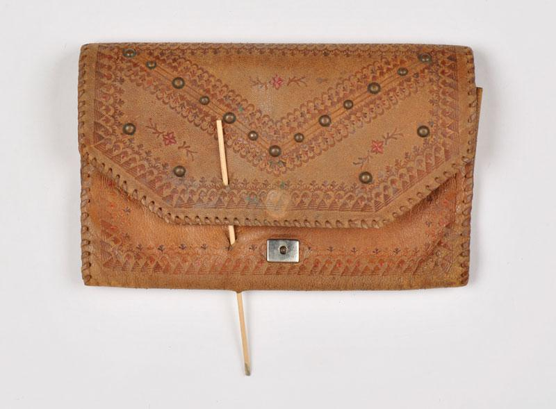 Wallet that protected Dov Weissberg from being injured by a bullet in his hiding place in Warsaw