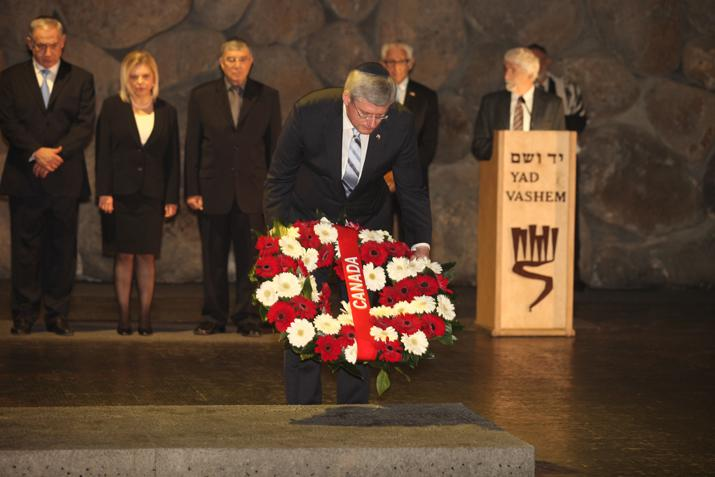 On 4 June 2012, Lily Safra (center), Yad Vashem Benefactor and Chairwoman of the Edmond J. Safra Prime Minister of Canada Stephen Harper lays a wreath in the Hall of Remembrance at Yad Vashem on 21 January 2014
