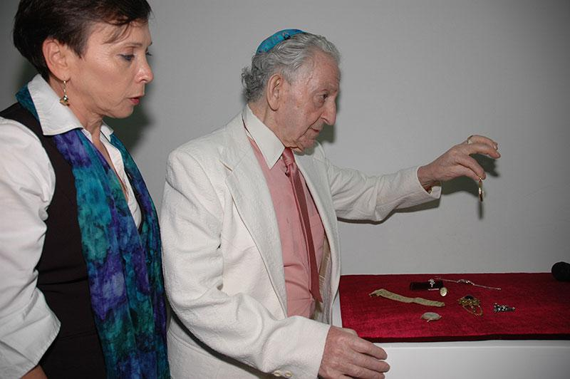 Meyer Hack at the ceremony marking his donation of jewelry that he hid as a prisoner in Auschwitz, with Haviva Peled-Carmeli, Director of the Artifacts Department, January 2009
