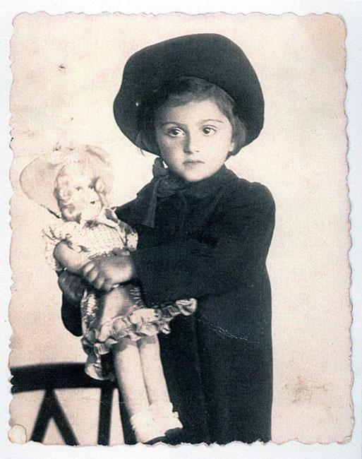 Éva Modvál as a child with one of her dolls, Transylvania, before the war