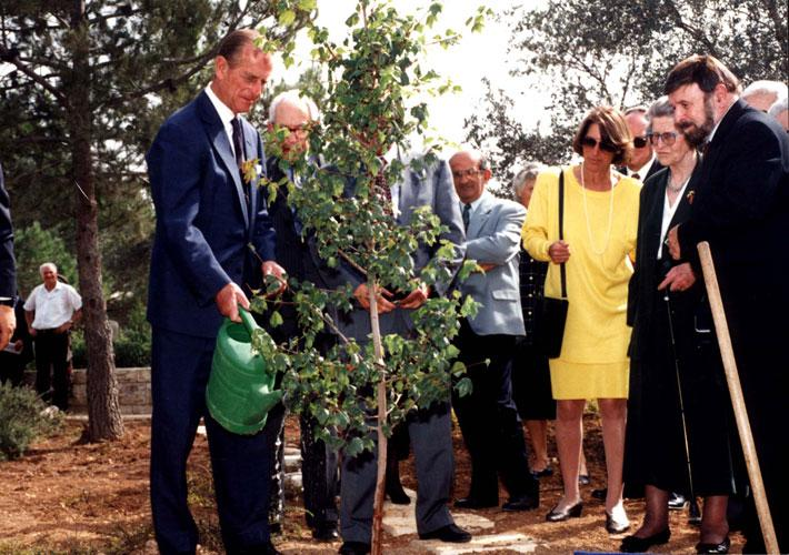 Prince Philip plants a tree in memory of his mother, Princess Alice, during the ceremony at Yad Vashem, 30 October 1994