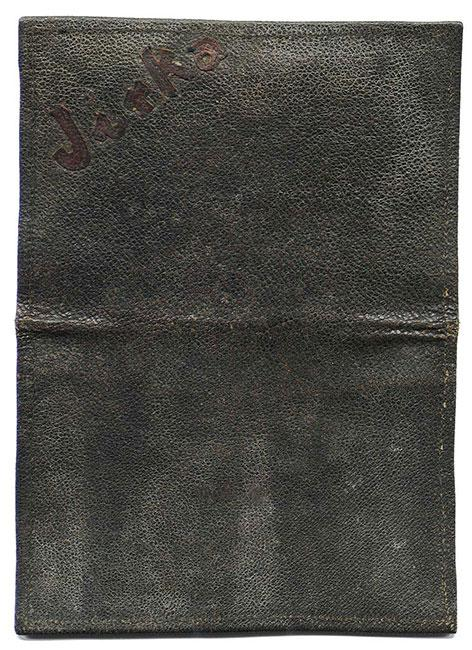 """Leather wallet embossed with the name """"Jirka"""", Jiri Bader's nickname. He received the wallet as a gift for his Bar Mitzva, which he celebrated in the Theresienstadt ghetto in 1944"""