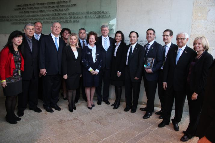 After exiting the Children's Memorial, Prime Minister Stephen Harper meets Canadian friends of Yad Vashem.
