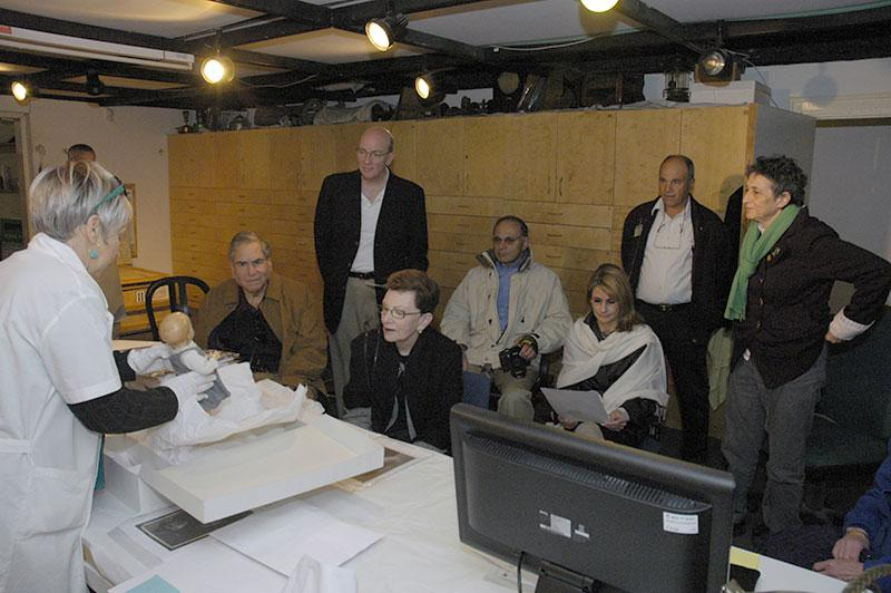 Haviva Peled-Carmeli, Director of the Artifacts Department, showing the Artifacts Collection to donors. Far right, Yehudit Inbar, Director of the Museums Division, 2011