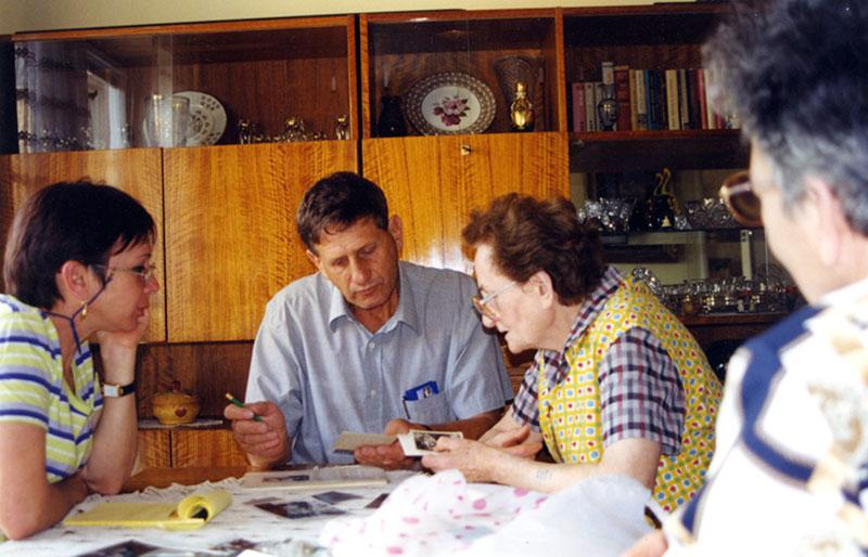 Katherina Gruenstein donating personal belongings that had been safeguarded by neighbors after her family was deported to the death camps, Hodonin, Czech Republic, 1999