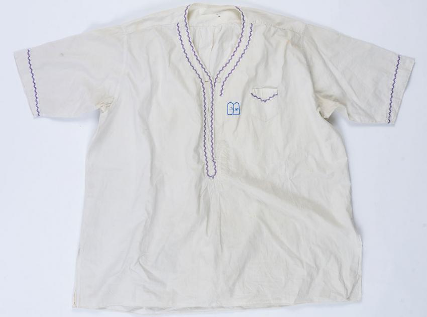 Shirt that Chaya-Fruma (Chayke) Daich embroidered in the Kovno ghetto for her brother Shmuel Daich before he left  to join the partisans in the forest