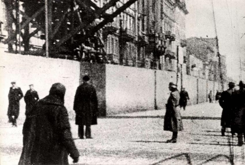 German guard in front of the Warsaw Ghetto wall, Poland, February 1943
