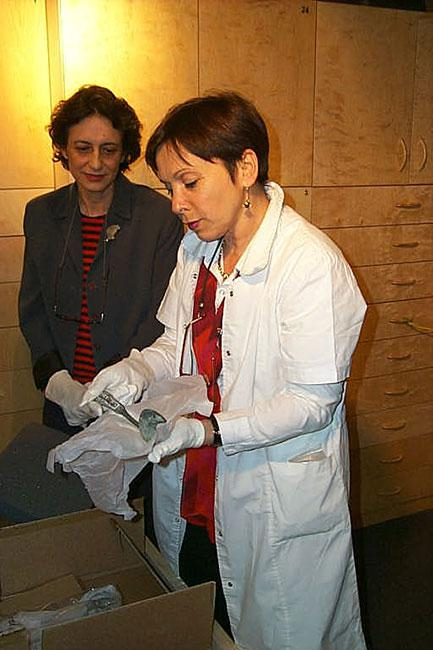 Haviva Peled-Carmeli, Director of the Artifacts Department and Yehudit Inbar, Director of the Museums Division viewing artifacts that arrived at Yad Vashem from the site of the Chelmno death camp in preparation for their display in the new Museum