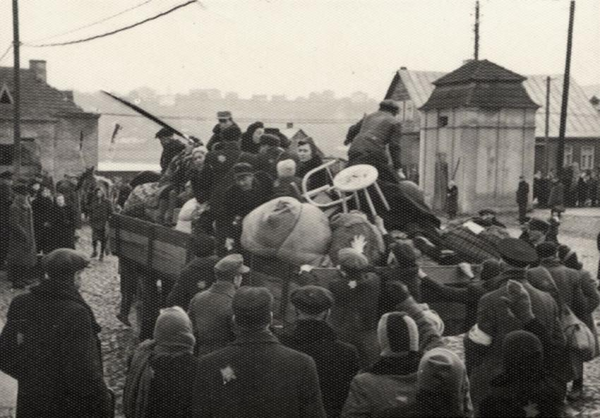 Jews being loaded onto trucks with their luggage during a deportation from the Kovno Ghetto, Lithuania, October 1943