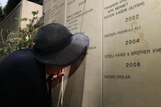 Vera Uglješić, saved by the rescuers and married Zlatan Uglješić after the war, kissing Zlatan's name on the wall, Garden of the Righteous, Yad Vashem, 29 May 2013