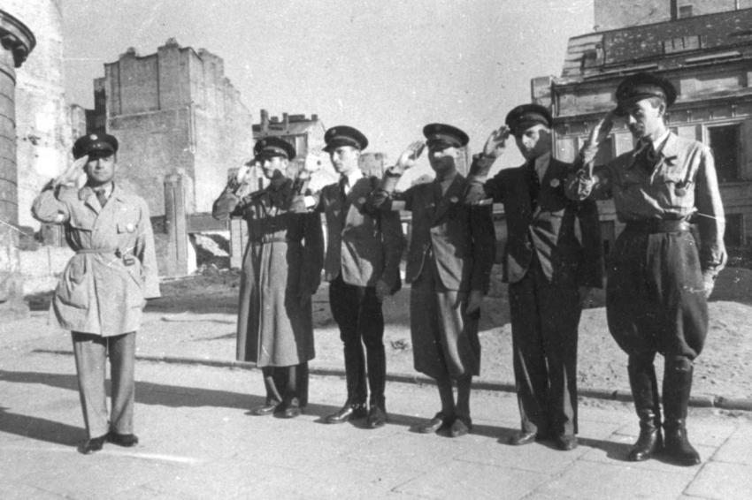 A roll-call of six Jewish policemen in the Warsaw Ghetto, Poland, July 1942