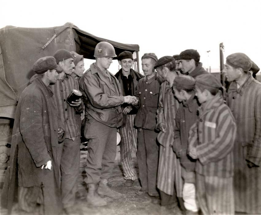Private Hershel Wright of the US Army gives oranges to starving survivors of the Wöbbelin concentration camp