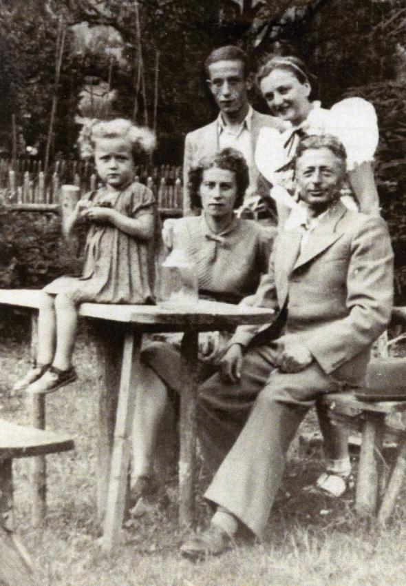 Little Sala Armel with her parents Feiga and Israel and brother Jozef Joel with young woman
