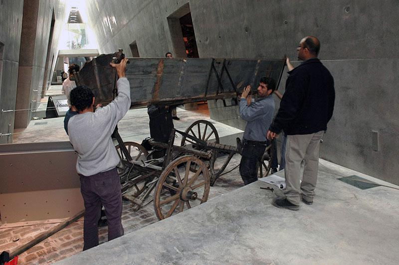A wooden cart, displayed as a symbol of the deportation of Jews to the ghettos, being put in place in the Holocaust History Museum at Yad Vashem, 2004
