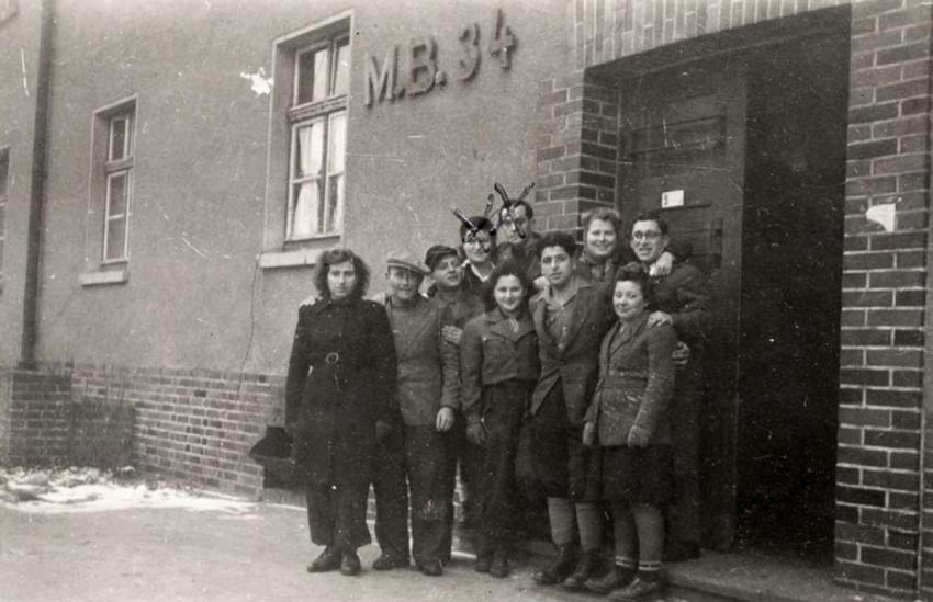 A group of survivors in Bergen-Belsen Displaced Persons' Camp, Germany, December 1945
