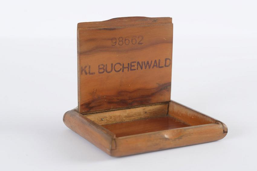 Wooden cigarette box that Alexander (Rosenberg) Ruziak made after his liberation from Buchenwald, stamping it with his prison number and the name of the camp