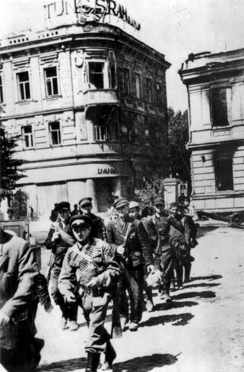 Jewish partisans entering the liberated city of Vilna, Lithuania, July 1944