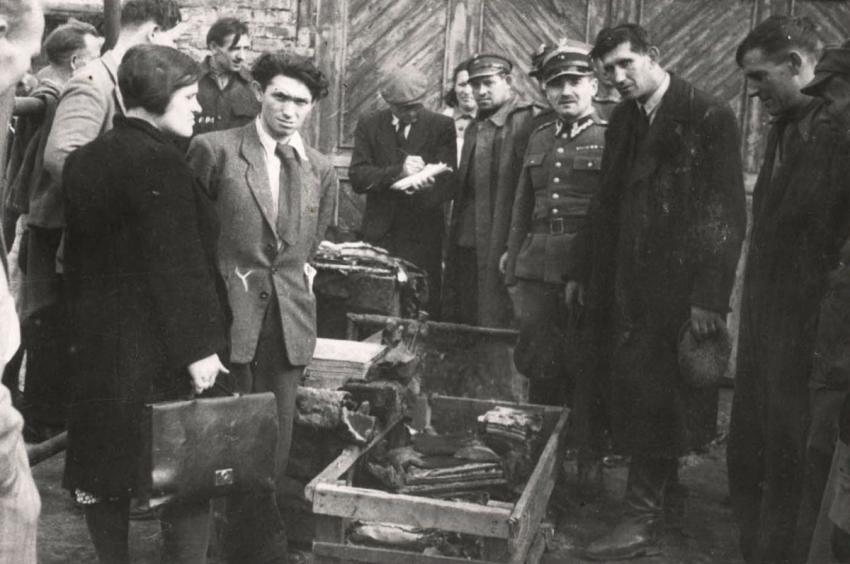 Discovery of one of the hiding places of the archival materials of the Lodz Ghetto Archive at #13 Lutomierska Street, the former site of the fire department of the ghetto, October 1946