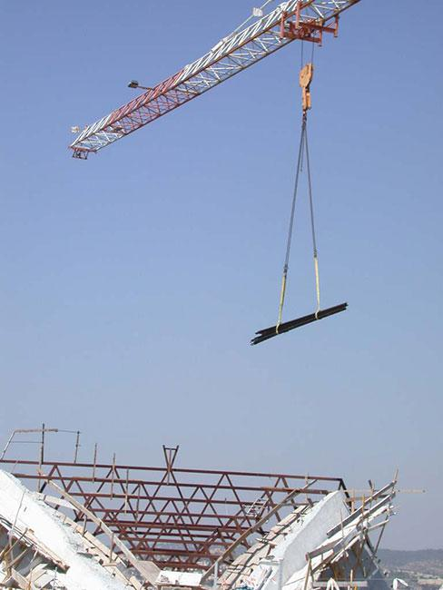 Railway tracks that led to Auschwitz, being lowered into the Holocaust History Museum through the uncompleted roof. 2004