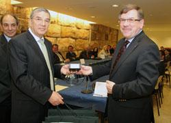 Yad Vashem Chairman Avner Shalev receives microfilms of the archival collection from Luxembourg from Prof. Paul Dostert at Yad Vashem. Photo: Isaac Harari