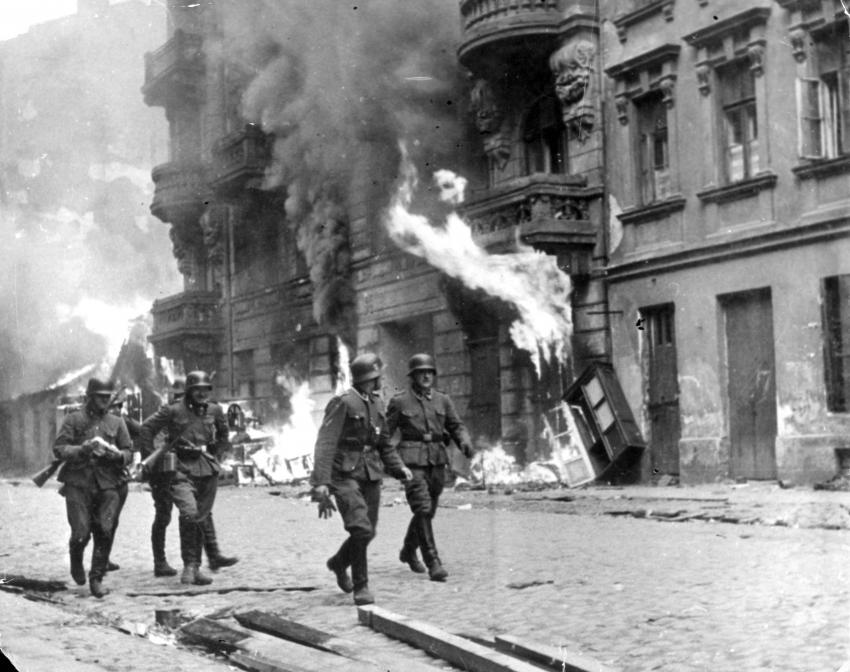 Warsaw, Poland, 1943, General Stroop's men next to burning buildings during the suppression of the uprising
