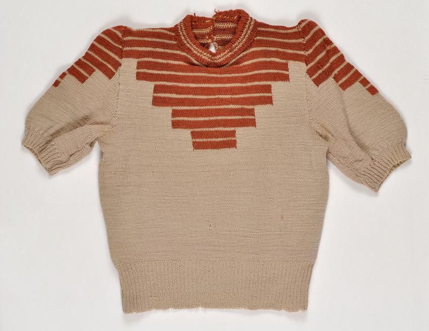 Sweater that Gucia Wald Teiblum knitted in the Bergen-Belsen DP camp using two wooden sticks, and wool unraveled from the socks of German soldiers