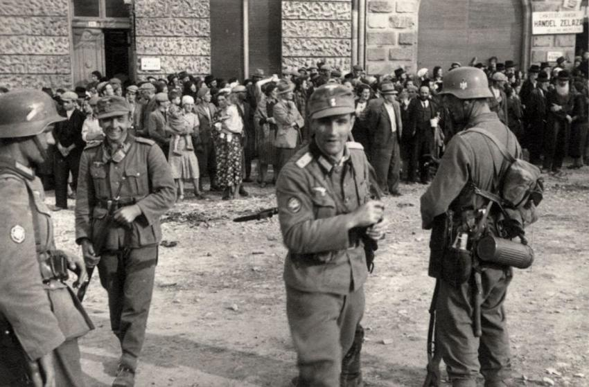 German soldiers guarding a group of Jews in Sanok, Poland, September 1939