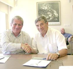 Douglas Greenberg, (left) president and CEO of the Shoah Foundation, and Avner Shalev, chairman of the Yad Vashem Directorate, after signing the agreement at Yad Vashem