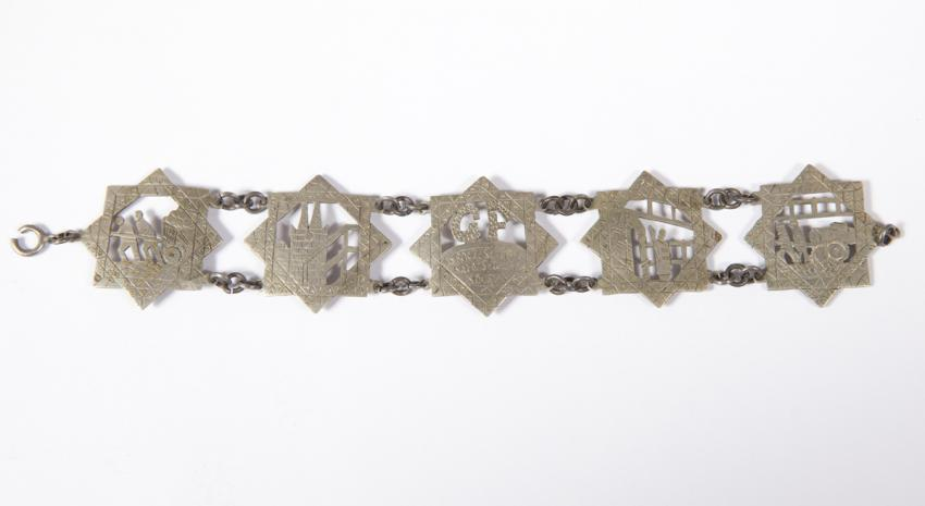 Bracelet found in the liquidated Lodz ghetto, engraved with depictions of life in the ghetto and the date 30 September 1943