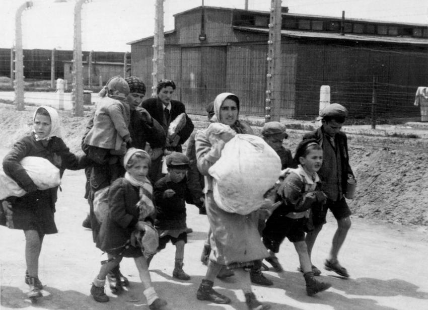 Birkenau, Poland, May, 1944, Women and children deemed unfit for work on their way to gas chamber number four
