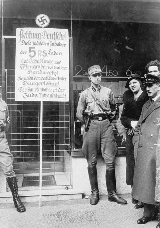 SA members standing outside of a Jewish-owned store in Berlin during the boycott against Jewish businesses, April 1, 1933