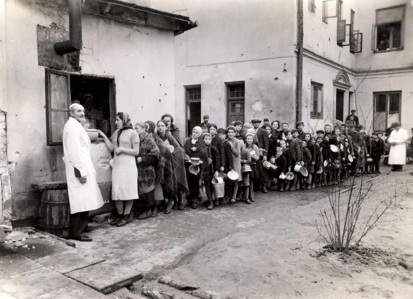 Jewish refugees waiting in a soup line at a shelter at 33 Nalewki Street