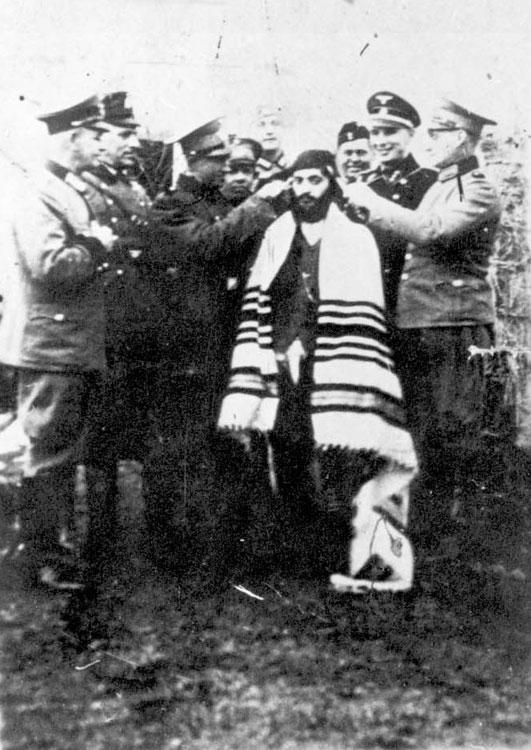 An Orthodox Jew being abused by Nazis in Kozienice, Poland, September 1939
