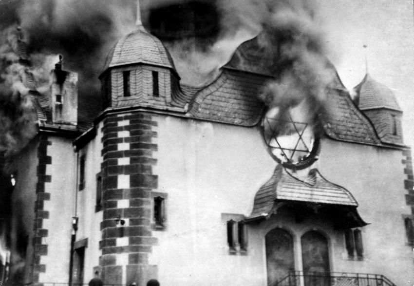 Flames pouring out of a synagogue in Siegen, Germany, during Kristallnacht, November 9/10, 1938